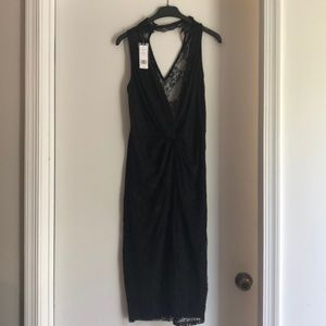 NWT BEBE black lace dress.